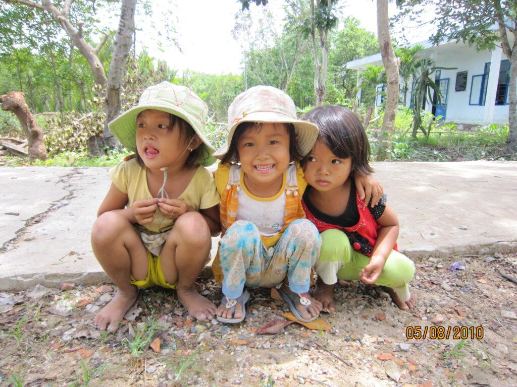 Smiling children huddled together