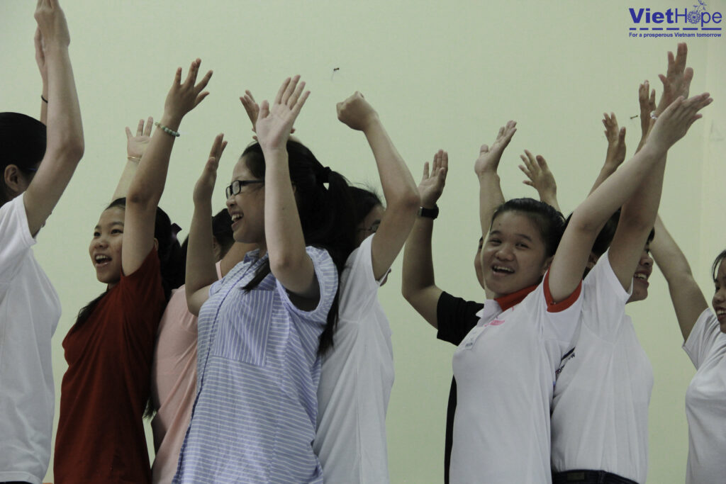 Group of students with hands raised